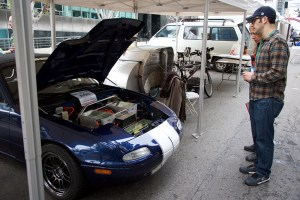 two adults with modified Miata