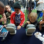 kids playing with educational robots
