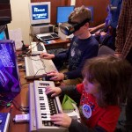 kids using VR and other computer gear