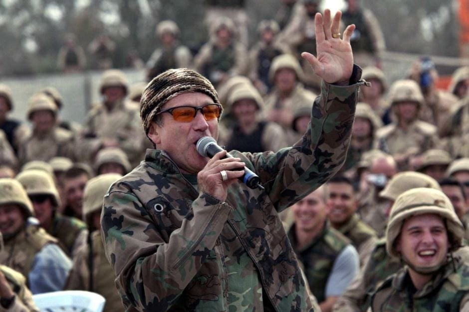 Image result for photo of Robin Williams performing for the troops
