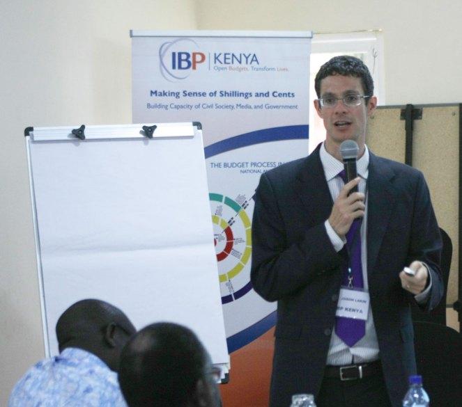 Jason Lakin, Ph.D. Country Manager Kenya at International Budget Partnership addressing the meeting