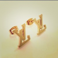 Louis Vuitton - Small gold plated LV stud earrings from ...