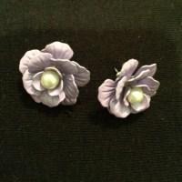 Charlotte Russe - Big purple flower stud earrings from ...