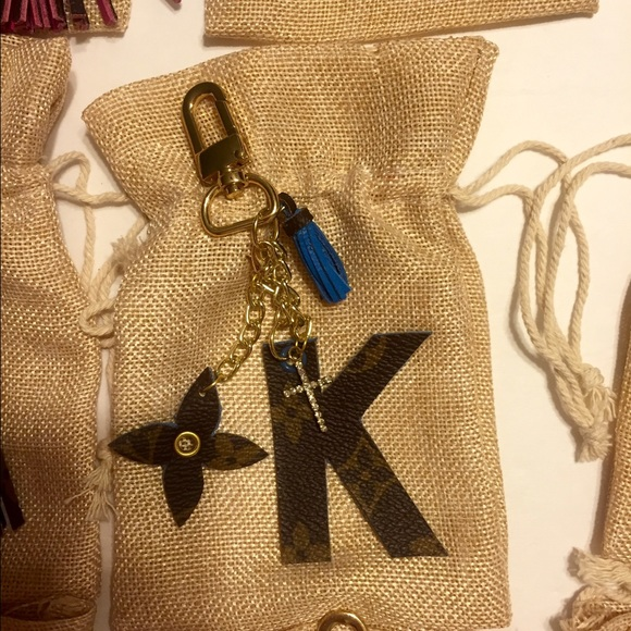 90% off Louis Vuitton Accessories - Upcycled Louis Vuitton BagCharm with Pom pom from Missnurseabbie's closet on Poshmark