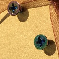 Iridescent multi-colored screws earrings from *sheila's ...