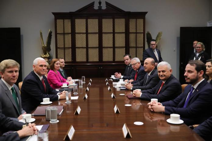 Turkish Foreign Minister Mevlut Cavusoglu (3 R), Turkish Energy and Natural Resources Minister Berat Albayrak (R), Turkish Ambassador to the United States Serdar Kilic (4 R) and Binali Yildirim's foreign affairs adviser Kerim Uras also attended the meeting with Mike Pence (2L). (Photo AA)
