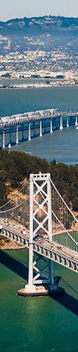 An aerial photo of a bridge in San Francisco bay.