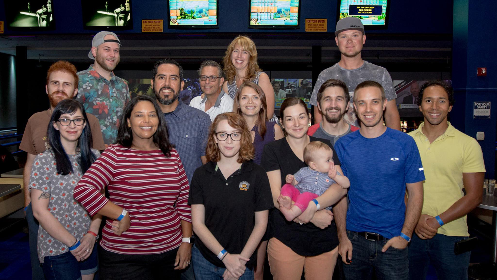 The DTX Media crew bonding at a bowling ally