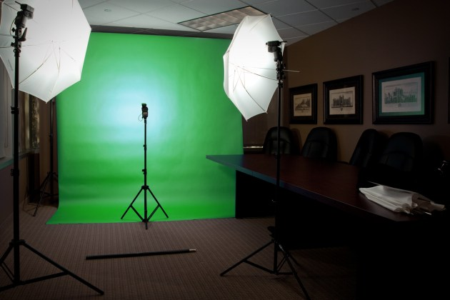 a green screen mobile studio set up in an office in dallas, with light stand and a photography backdrop