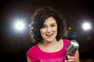 21 singing with microphone