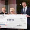 Dallas Cowboys Jason Witten receives a charity check, posing for photography and video