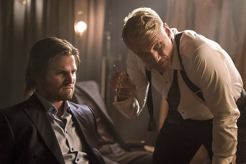 "Arrow -- ""So It Begins"" -- Image AR506a_0233b.jpg -- Pictured (L-R): Stephen Amell as Oliver Queen and Dolph Lundgren as Konstantin Kovar -- Photo: Katie Yu/The CW -- © 2016 The CW Network, LLC. All Rights Reserved."