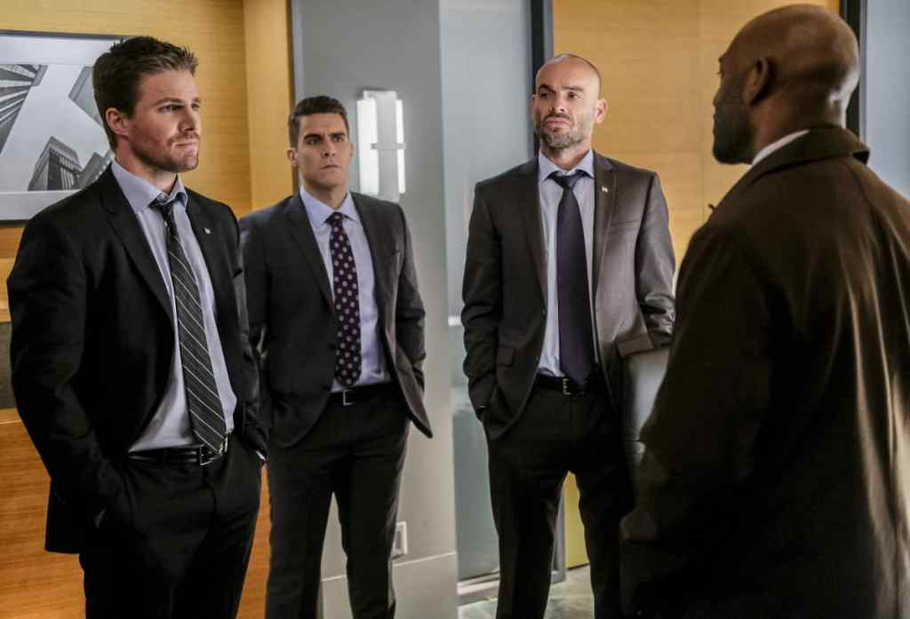 """Arrow -- """"The Sin-Eater"""" -- Image AR514a_0083b.jpg -- Pictured (L-R): Stephen Amell as Oliver Queen, Josh Segarra as Adrian Chase, Paul Blackthorne as Quentin Lance and Adrian Holmes as Captain Frank Pike -- Photo: Robert Falconer/The CW -- © 2017 The CW Network, LLC. All Rights Reserved."""