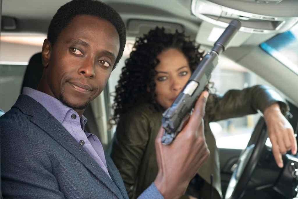 "THE BLACKLIST: REDEMPTION -- ""Whitehall"" Episode 107 -- Pictured: (l-r) Edi Gathegi as Matias Solomon, Tawny Cypress as Nez Rowan -- (Photo by: Virginia Sherwood/NBC)"