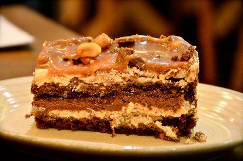 Chocolate Peanut Butter Stack - dhs 26 (Sweet and salty peanut butter crunch layered with light and creamy milk chocolate and buttery caramel, on a fluffy brownie cake base.)