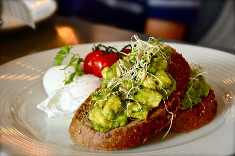 Avocado Toast - AED 58 with slow roasted tomatoes, toasted seeds & poached eggs