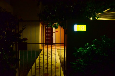 Our Pool Residence villa entrance at night