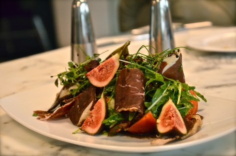 HEIRLOOM TOMATO SALAD, Lamb Prosciutto , Mission Figs, Green Olives - AED 75