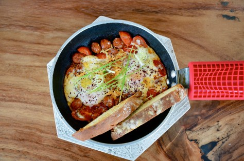Anatolian eggs - AED 42 - Baked eggs, zesty veal sausage, sumak yoghurt and rustic toast