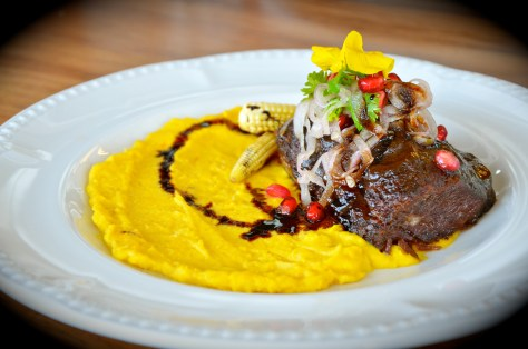 Braised Beef - AED 50 - Slow braised beef, corn puree, espanola sauce pomegranate, shallots and coriander
