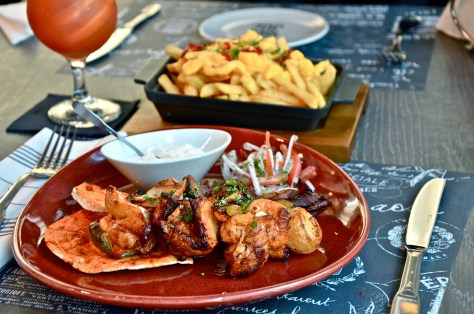 Kebabs of Marinated Lamb & Chicken Tikka - Aed 70 along with grilled vegetables & house fries