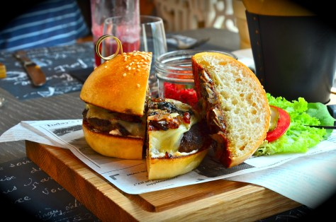 Mushroom & Swiss Cheese on Angus Beef Burger - Aed 70 with caramelized onions and rocca