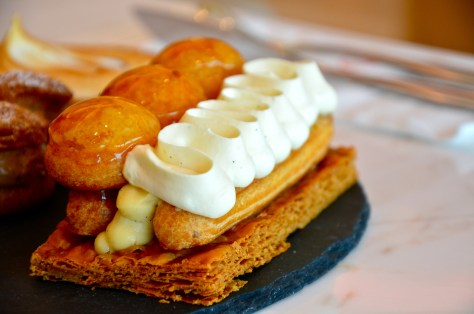 Saint-Honore - AED 35 - Cruncy and flaky pastry with rich caramel chouxpastry, smooth pastry cream and Saint-Honore cream