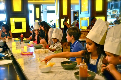 Children learning to make their own sweet dish at Bread Street Kitchen Family Brunch