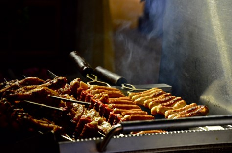Smoked sausages and other meats getting ready at the LIVE Grill station