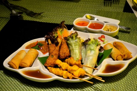 Mixed platter - AED 85 - An array of chicken satay, fish cake in sugar cane skewer, rice paper veggie rolls and deep fried vegetable spring roll