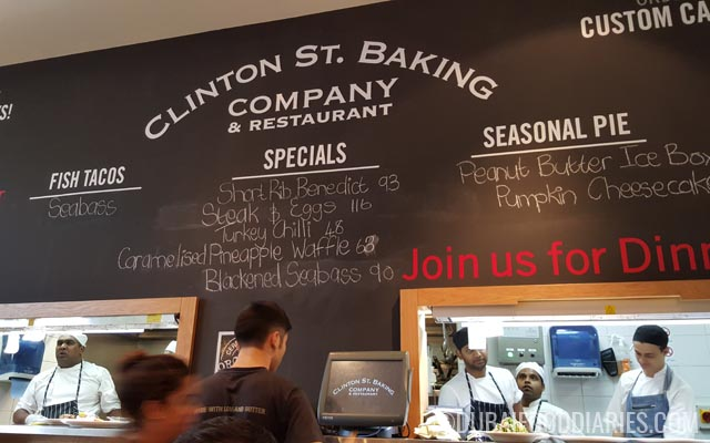 Chalkboard and kitchen at Clinton Street Baking Company Dubai