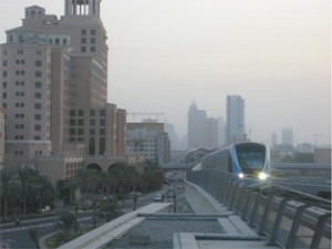 An in-bound train arriving at the Mall of the Emirates station.