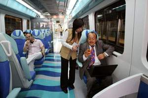 Patricio Porras, an expat from Ecuador speaks with Shuang Li, from China, a train attendant, on board the first train of the day on the Dubai Metro. (Randi Sokoloff / The National)