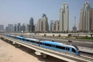 The Dubai Metro taking a test run past Dubai Marina yesterday, a week before its opening on September 9. Stephen Lock / The National