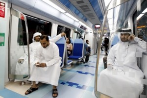 People take the first metro ride after the official opening of the Gulf Emirate's first metro network in Dubai, Sept. 9, 2009. (Mosab Omar/Reuters)