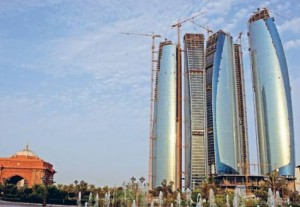 *  The Etihad Towers under construction in Abu Dhabi. Hani Al Hameli, Secretary General of the Dubai Economic Council, says there are encouraging signs of a turnaround.     * Image Credit: Alex Westcott/Gulf News
