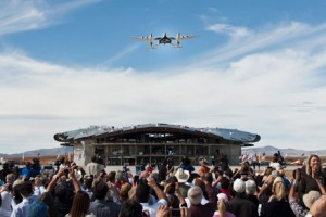 Stephen Attenborough, a director at Virgin Galactic, says Abu Dhabi could be the location for the company's first non-US spaceport. Above, the Virgin WhiteKnightTwo performs a flyover during an event commemorating the completion of the spaceport runway in New Mexico.  Christ Chavez / Bloomberg