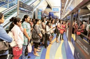 *  Image Credit: Pankaj Sharma/Gulf News     * Commuters at Khalid Bin Al Waleed Metro Station wait for the train. Passengers rode the Metro, public buses and water taxis for free as part of the Roads and Transport Authority annual Public Transport Day.