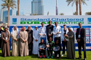 Winners with organizers and sponsors after the trophy presentation in the Standard Chartered Dubai Marathon. (AN photo)
