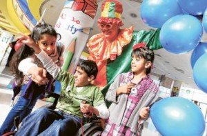 *  Image Credit: Asghar khan/Gulf News     * A child afflicted with a rare disease is entertained by friends and a clown at Saturday's opening of the National Awareness Campaign on Rare Diseases at Children's City, Creek Park in Dubai. The event, the second in two years, is organised by the Shaikh Hamdan Bin Rashid Al Maktoum Award for Medical Sciences.