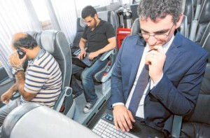 Image Credit: Abdel-Krim Kallouche/Gulf News     Passengers make use of the Wi-Fi facility in a bus operating between Dubai and Abu Dhabi.
