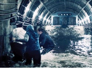 "A handout undated still photo provided by Profit Ltd Russian film-making company shows a scene from ""Metro,"" a disaster movie which pictures what might happen if Moscow's metro system sprung a leak from the Moscow River flowing above it and a speeding train crashed into a wall of water. — AFP"