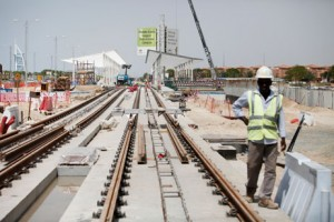 Workers lay tracks and build a station near Dubai Media City for the project. The trams are being manufactured in France. Sarah Dea / The National