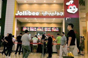 The Jollibee outlet in Dubai Mall has a separate token counter to help customers with ordering. Jeffrey E Biteng / The National