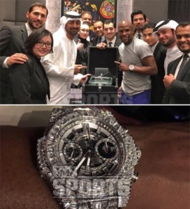 Mayweather with staff from the Hublot store (above) and the $1.1m watch (below).