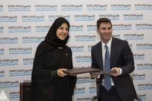 Reem Ibrahim Al Hashemi seen with Lionel Messi, who signed as Global Ambassador of Expo 2020 Dubai. (Supplied photo)