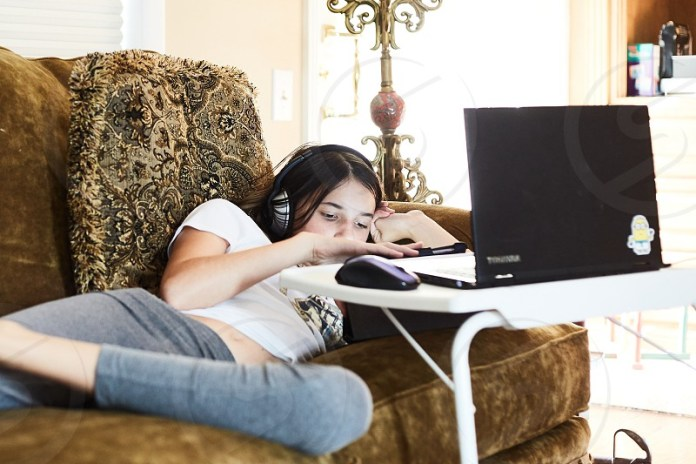 Female Relaxing With Computer