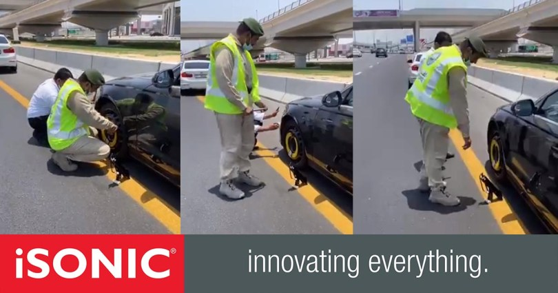 Dubai police have arrived in Dubai to help change the tires of a punctured car before Friday prayers_DUBAIVARTHA
