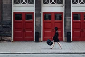 Girl walking past Massey Building