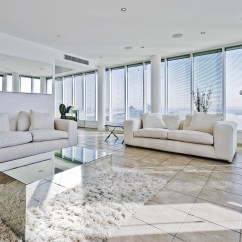 Tiled Living Room With Light Grey Couch Trending Tile Styles The Dublin Carpet Penthouse Luxurious
